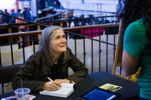 Amy Goodman signing books