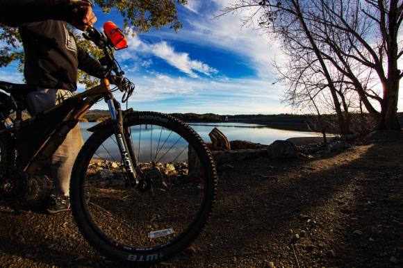 riding across the dam